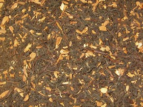 ORGANIC BLACK TEA:  loose leaf dark black tea is pictured with fair traded true sweet cinnamon chips in this custom blended premium tea from a Canadian Tea supplier offering made in Canada organic blends with wholesome ingredients at bulk discount tea prices.